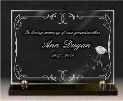 Glass memorial plaque, with engraving of decorative border and rose
