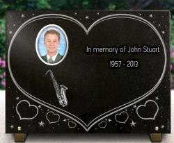 Big granite memorial plaque, heart background engraved in the mass