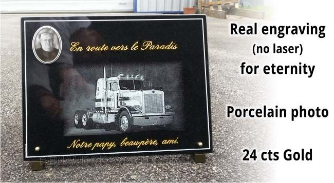 Customizable funeral plaque with truck engraved in granite surface.