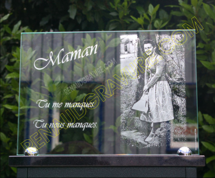 Engraver of glass burial plaques with engraved photo.