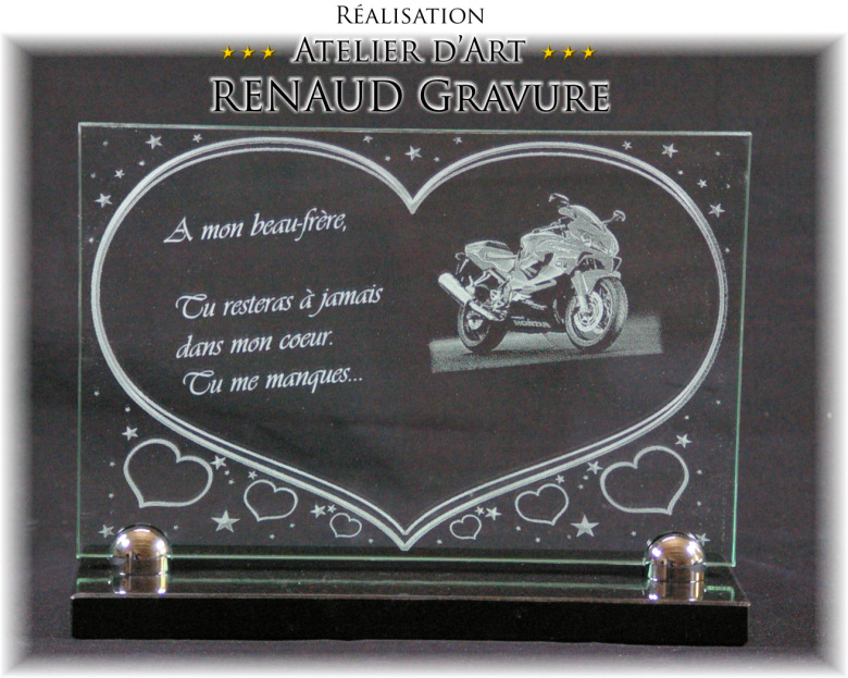 A glass heart funeral plaque with an engraved motorcycle.